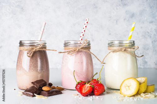 Foto op Aluminium Milkshake Banana chocolate and strawberry milkshakes