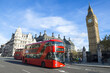 Bright scenic morning view of the London, England skyline at Westminster, with iconic modern double-decker bus passing Big Ben