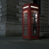 old red telephone booth at night in london