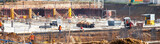operai al lavoro in cantiere edile - 157534923