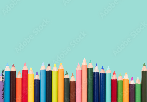 colored pencils in an arrangement on a white background Poster
