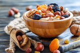 Wooden bowl with nuts and dried fruits. - 157582323