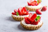 Fototapety Strawberry vanilla cream cheese tarts over light gray table