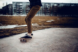 skateboarder guy prepares for a stunt on a skateboard and rides along the road. Concept forward to the goal and achieve it.