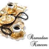 Islamic Holidays Golden coffee cups rosary white background