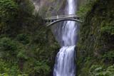 Multnomah Falls and foot bridge in lush green setting near Mount Hood and Portland Oregon in the Columbia River Gorge region, USA