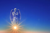 Angel over blue sky with rays of sun light with copy space - 157613764