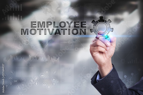 Businessman is drawing on virtual screen. employee motivation concept.