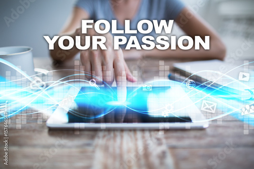 Woman using tablet pc, pressing on virtual screen and selecting follow your passion Poster