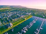 Aerial view of Mornington Peninsula coastline, suburbs, and marina at sunset. Melbourne, Australia