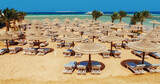 Chaise lounge and parasols on the beach against the blue sky and sea. Egypt, Hurghada - 157686187