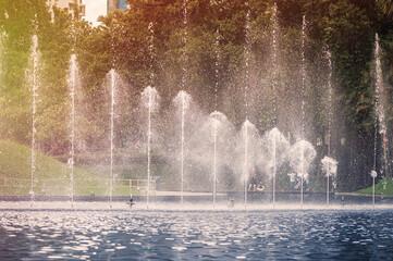 Fountain in KLCC Park in Kuala Lumpur on sunset. Malaysia