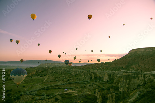 Fotobehang Lichtroze Beautiful balloons in sunrise light in Cappadocia
