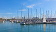 Sailboats moored in the port of barcelona, near the Ramblas and the monument of Columbus. Barcelona, Spain