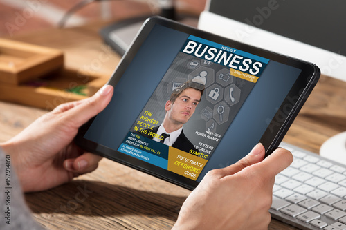 Businessperson Looking At Business Magazine Poster