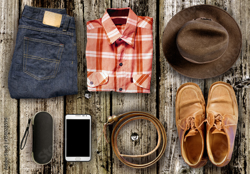 Overhead view Men casual outfits on wood background Poster