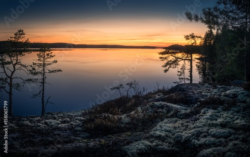 Scenic landscape over lake with sunset at spring evening in Finland