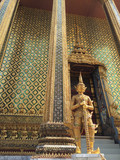 Golden giant guardian in front of gate at Wat Phra Kaew, Temple of the Emerald Buddha , Bangkok Thailand