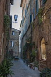 Beautiful narrow street in the small magical and old village of Pienza, Val D'Orcia Tuscany - Italy