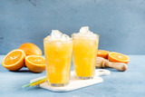 Glass of orange juice with ice cubes Cold orange fresh Glass of orange juice for hot summer day Copy space