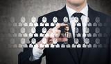 Fototapeta Businessman picking a candidate for a job