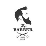 Fototapety The Barber. Handsome man with beard and mustache. Scissors. Barber shop symbol.