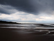 heavy storm on a beach with dark clouds