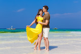 Couple having fun on tropical beach. Summer vacation concept. - 158223703