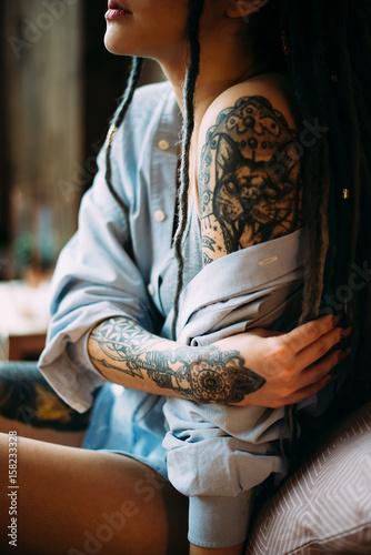 Beautiful woman with dreadlocks and tattoos. Lips and hands closeup. Boho style - 158233328