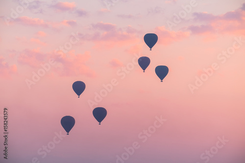 Hot Air Balloon with Dramatic Sky in Morning Poster