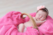 newborn sleeping in basket, baby girl lying in pink blanket, cute child, daughter announcement