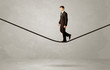 Salesman walking on rope in grey space - 158244547