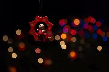 Christmas Decoration - Beautiful magic bokeh with wooden ornament.
