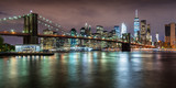Panoramic view of the Brooklyn Bridge with Financial District skyscrapers at twilight and light clouds. Lower Manhattan, New York City - 158268703