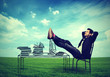business man relaxing at his desk outdoors in the middle of a green meadow