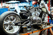 Background image of big disassembled motorcycle on stand in workshop, ready for repair, tune up and customizing works