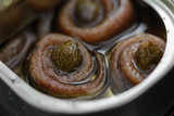 Anchovy rolls with capers in olive oil in tin. Close up - 158275964