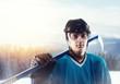 Ice hockey player in helmet and equipment