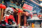 Burning incense in Wong Tai Sin Temple in Hong Kong