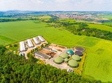 Aerial view over biogas plant and farm in green fields. Renewable energy from biomass. Modern agriculture in Czech Republic and European Union.  - 158290770