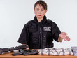 Female Asian police officer showing seized goods