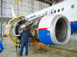 Replacing the engine on the plane, working people tap. Concept maintenance of aircraft.