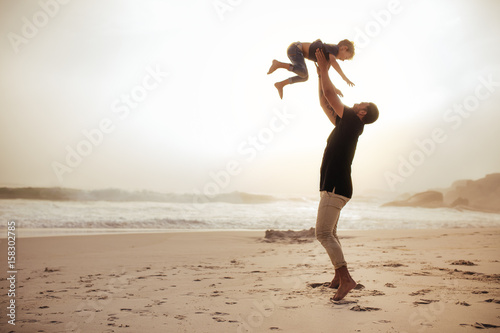 Father and son enjoying holidays at the sea shore