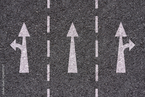 Foto Murales white arrows and lines on asphalt texture - freeway exit