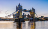 Tower Bridge in London at Sunset, the UK. Drawbridge opening. One of English symbols