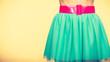 Pink belt on blue tulle skirt