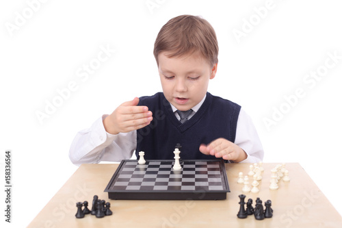 Boy playing chess Poster