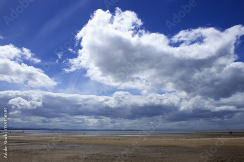 Crosby beach in England landscape. Cloudy day Poster
