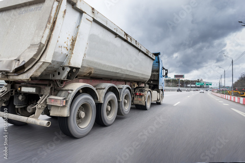 In de dag A lorry with tipping trailer in motion on the motorway