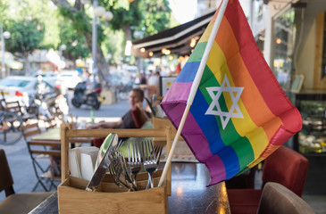 Rainbow flags with the jewish star of David at undefined cafe in Israel